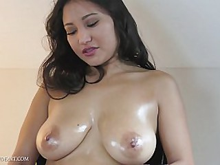 Sexy Asian babe with big tits masturbates with sex toy