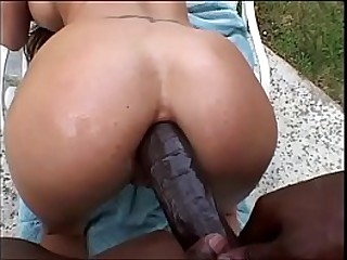 Busty Asian loves a big black cock deep in her ass