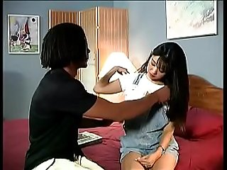 Horny young Asian schoolgirl gets fucked in all poses by a black guy