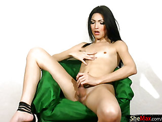 Cute t-girl fondles her small titties and shaved bubble ass