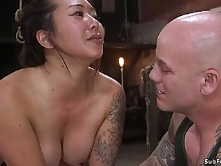 Baldheaded master Derrick Pierce finger fucks pussy to busty brunette Asian slave Jasmine Ryder in doggy style rope bondage then fucks her with big cock