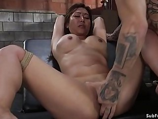 Brunette Asian slave Jasmine Ryder in breast bondage gets pussy rubbed by master Derrick Pierce then rough banged in doggy style position