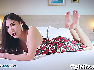 Oriental tgirl sways her pale feet around