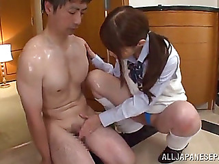 Rei aimi gives a chap an oil massage in advance of riding his hard weenie
